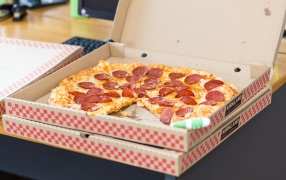 Pizza in a takeaway box